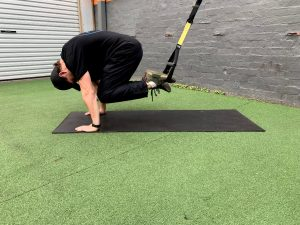 Damien performing a crunch using a suspension trainer