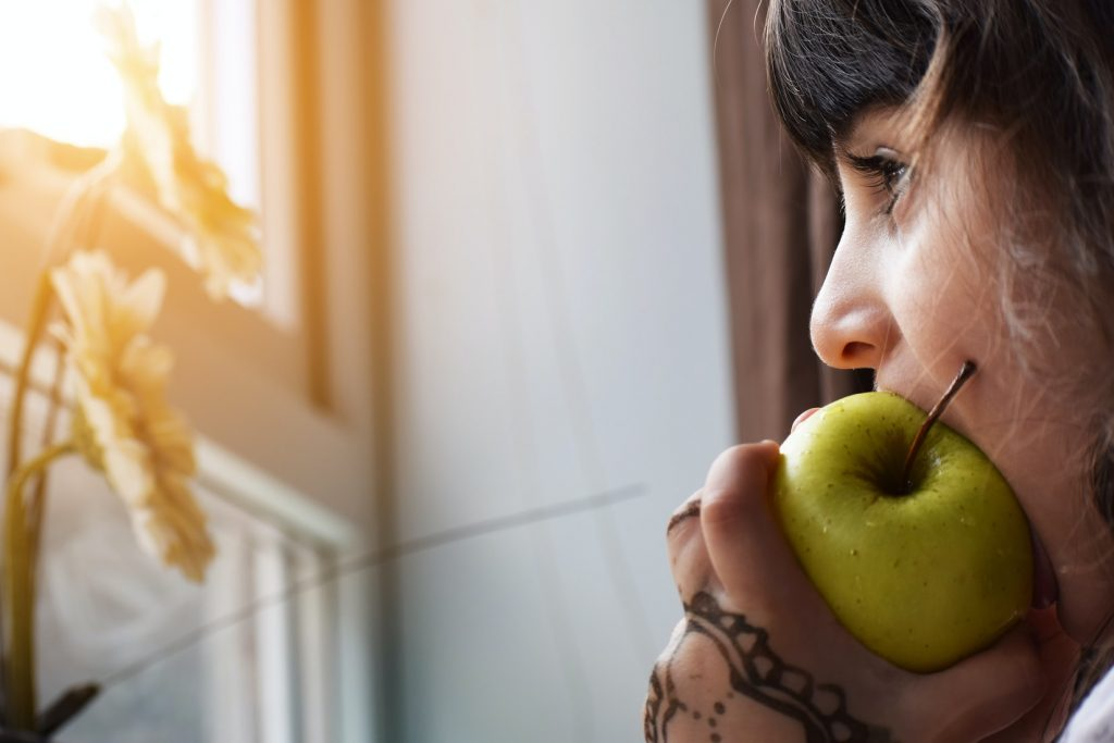 Lady Eating and Apple