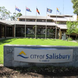 City of Salisbury sign with flag in background